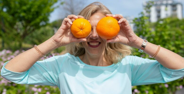 Woman and Oranges Image
